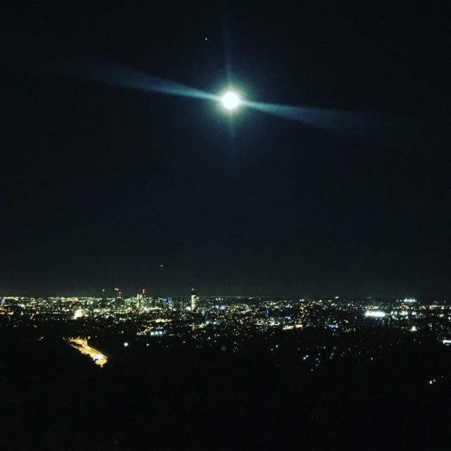 Bright moon over brisbane from Mt Cootha nightsky greentravel skylinehellip