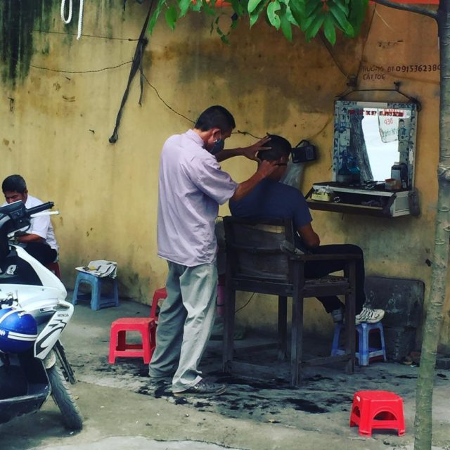 Street side barber in Hai Phong vietnam haircut shave greenhellip